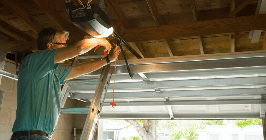 man repairing garage door opener