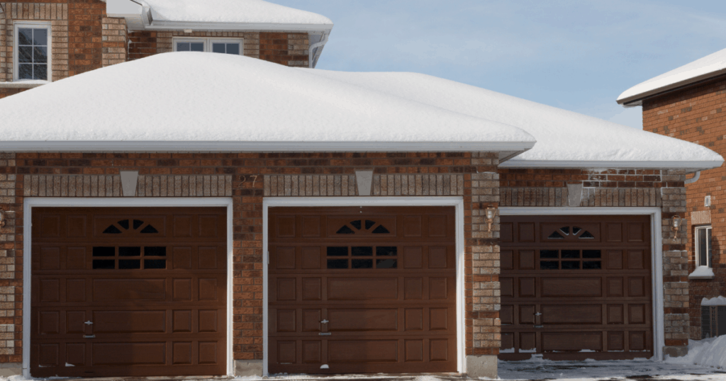 three car garage with snow in front